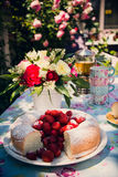 Flower bouquet of roses and angelfood cake. Flower bouquet of pink white red roses and an angelfood cake Stock Images