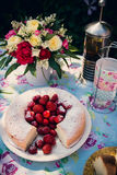 Flower bouquet of roses and angelfood cake. Flower bouquet of pink white red roses and an angelfood cake Royalty Free Stock Image