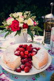 Flower bouquet of roses and angelfood cake. Flower bouquet of pink white red roses and an angelfood cake Royalty Free Stock Photo