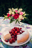 Flower bouquet of roses and angelfood cake Royalty Free Stock Image