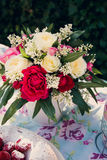 Flower bouquet of roses and angelfood cake Royalty Free Stock Photography
