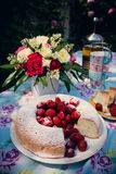Flower bouquet of roses and angelfood cake Royalty Free Stock Images