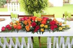 Flower bouquet with roses wedding. A wonderfull bouquet for a wedding,  Is a short bouquet plenty of roses, red, yellow, orange, Give life to the decoracion of Stock Photos