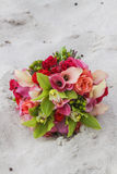 Flower bouquet in sand. Closeup of a colorful flower bouquet in sand Royalty Free Stock Photography