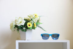 Flower bouquet with sunglasses on rack Royalty Free Stock Image