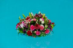 Flower bouquet at swimming pool in wedding party for decoration. Colorful flowers float in the pool Stock Photography