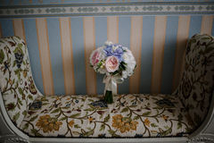 Flower bouquet on tapestry chair Stock Image