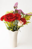 Flower bouquet in a vase. In a white background Stock Photos
