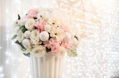 Flower bouquet in vase with white light bokeh. Background Royalty Free Stock Photos