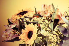 Flower bouquet, vintage washed out, yellow and violet colors. Stock Images