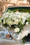 Flower bouquet on wedding car. Big white flower bouquet on wedding car. Vertical shot Royalty Free Stock Photos