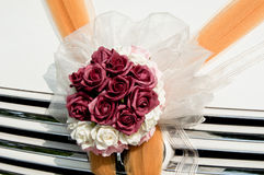 Flower bouquet on wedding car Stock Photos