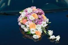 Flower bouquet. Wedding flower bouquet on car front Stock Photos