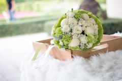 Flower bouquet on wood plate. Flower bouquet wedding on wood plate royalty free stock photos