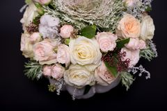 Flower bouquet in a white pumpkin on a black background, a mixture of flowers, peony rose, eucalyptus, chrysanthemum royalty free stock images