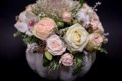 Flower bouquet in a white pumpkin on a black background, a mixture of flowers, peony rose, eucalyptus, chrysanthemum stock images