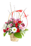 Flower bouquet. On wood basket  on white Royalty Free Stock Photography