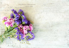 Flower bouquet on a wooden old bench.  Stock Photos