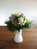 Flower bouquet on wooden table Royalty Free Stock Image