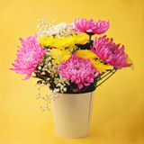 Flower bouquet on yellow background Stock Photos