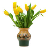 Flower bouquet from yellow tulips in vase isolated on white back Stock Photos