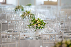 Flower bouquete decoration careing interior. Serviette table Stock Photo