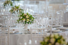 Flower bouquete decoration careing interior. Serviette table Royalty Free Stock Photography
