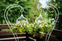 Flower bouquets in cages Stock Images