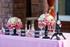 Flower bouquets w/Eiffel towers on a wedding table Stock Photos