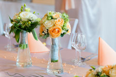 Flower bouquets on wedding dining table Royalty Free Stock Images