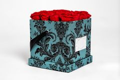 Flower box intended for home decor, weddings, anniversaries, birthdays and other celebrations. Red roses. Also could be a very special gifts for your partner stock image