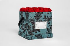 Flower box intended for home decor, weddings, anniversaries, birthdays and other celebrations. Red roses. Also could be a very special gifts for your partner stock images