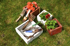 Flower boxes and old garden tools Royalty Free Stock Photos