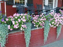 Flower Boxes on Porch. Porch FLower Boxes and Rockers Royalty Free Stock Photography