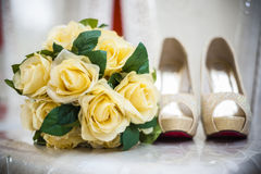 Flower and bride's shoes Stock Image