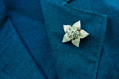 Flower brooch. On a business female suit of blue color Stock Photo