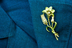 Flower brooch. On a business female suit of blue color Stock Images