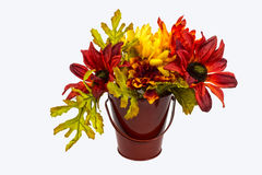 Flower bucket. Assorted flower in a bucket against a white back ground Stock Images