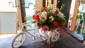 Flower bucket on byte Stock Photography