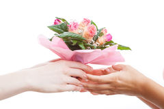 Flower bunch gift. A man giving a woman a bunch of pink flowers stock image