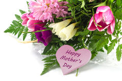 Flower bunch and a pink heart shape with text happy mother's day Royalty Free Stock Photos