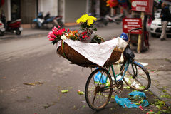 Flower bunches on the bicycle at the market in Asia Stock Images