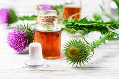 Flower and burdock extract Royalty Free Stock Photo