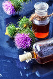 Flower and burdock extract Stock Photography