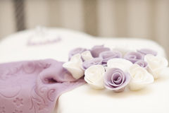 Flower on the cake. Flowers on the cake and background from stripes royalty free stock image