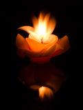 Flower candle on fire Royalty Free Stock Photos