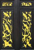 Flower carved gold paint on wood door royalty free stock photos