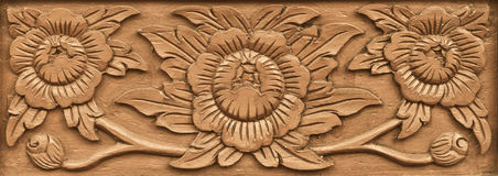 Flower carved on wood Royalty Free Stock Image