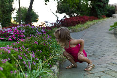 Flower Child. Young Girl Smelling Flowers in a Botanical Garden Royalty Free Stock Images