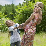 Flower children outdoors Royalty Free Stock Image